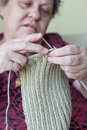 Knitting hands of a senior woman Stock Photo