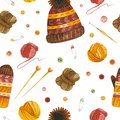 Knitting hats and gloves watercolor seamless pattern.