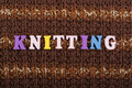 Knitting. Knitted Fabric Texture. Word composed from ABC alphabet letters.