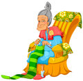 Knitting lady happy old sitting on the couch and Stock Photo