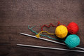 Knitting needles and ball of threads colorful on wooden background Stock Photography
