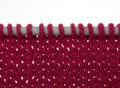Knitting on needles, stocking stitch, over white Royalty Free Stock Photography