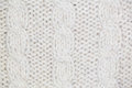 Knitting pattern from gray woolen warm soft yarn Royalty Free Stock Photo