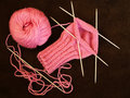 Knitting ping knitted sock on brown background Royalty Free Stock Photography