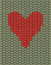 Knitting red heart on the green backgound Stock Image