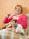 Knitting senior woman Royalty Free Stock Image
