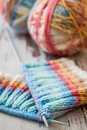 Knitting with spokes colorful and ball of yarn on white wooden table Royalty Free Stock Photography