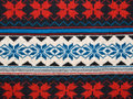 Knitting texture with ornament red white  blue Royalty Free Stock Photos