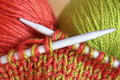 Knitting wool and needles closeup Stock Photos