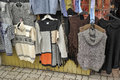 Knitwear hung for sale at flea market Royalty Free Stock Photo