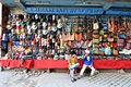 Knitwear stall in thamel kathmandu nepal keepers and their selling hats and bags Stock Photos