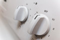 Knobs on a stove close up with shallow depth of field range in off position Stock Photography