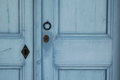 Knocker and lock on the blue wooden door Royalty Free Stock Photo