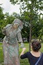 Knocks fists boston massachusetts usa june woman dressed as copper statue with woman on boston common Royalty Free Stock Images