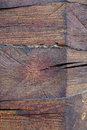 Knot on a log house detail vertical closeup background Royalty Free Stock Image