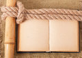 Knot sea and old book on background of the fabric Royalty Free Stock Image