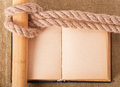 Knot sea and old book on background of the fabric Stock Image
