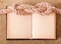 Knot sea and old book on background of the fabric Stock Images