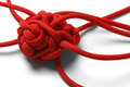 Knot tangle red rope in a tangled mess isolated on white background Royalty Free Stock Photos