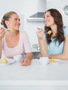 Knowing women eating cake and having coffee together Royalty Free Stock Photo