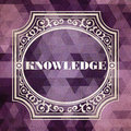 Knowledge concept vintage design background purple made of triangles Stock Images