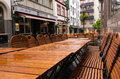 Koblenz wet restaurant tables on the street at the rainy day germany Stock Photo