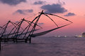 Kochi chinese fishnets sunset fort kochin kochi kerala india Stock Photo
