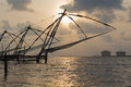 Kochi chinese fishnets sunset fort kochin kochi kerala india Royalty Free Stock Image