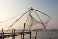Kochi india chinese fishing nets fishnets on sunset kerala Stock Images