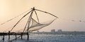 Kochi india chinese fishing nets fishnets on sunset kerala Stock Photo