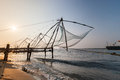 Kochi india chinese fishing nets fishnets on sunset kerala Stock Photos