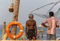 Kochin india february fishermen on the city port on februar in indian using traditional chinese network Stock Image
