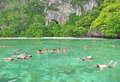 Koh yung or yung island krabi thailand – november tourists snorkeling in the sea on november in krabi thailand has a stone beach Stock Image