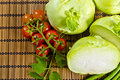 Kohlrabi, tomatoes and young peas Stock Photos