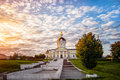 Kolomna Church of the Archangel Michael with a bell tower at dawn with beautiful clouds and Golden light. Horizontal Royalty Free Stock Photo