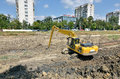 Komatsu excavator cleaning the river bed Stock Images