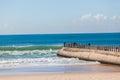 Konkreta pier fishermen sea blue waves Arkivbilder