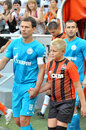 Konstantin zyryanov comes with a boy on the field before match between shakhtar donetsk city ukraine vs zenit st petersburg Stock Images