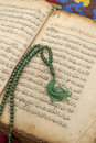 Koran ancient hand scripted with prayer beads Royalty Free Stock Image