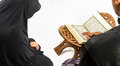 Koran in hand - holy book of Muslims( public item of all muslims Royalty Free Stock Photo