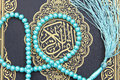 Koran holy book with rosary