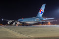 A of korean air prague march airbus ready to taxi at night on prague airport on march is flag carrier and the largest Royalty Free Stock Photo