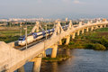 Korean bullet train locomotive on a concrete bridge over a river Stock Image