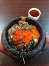 Korean food a colorful bowl of traditional with meat vegetables and a spicy sauce on the side Stock Image