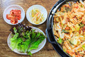 Korean food compose of kimchi fresh lettuce bean sprouts and stir fried vegetables with chicken on wood table Stock Image