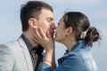 Korean girl embrasing and kissing her european boyfriend Royalty Free Stock Photo
