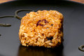 Korean rice sweet treat close up of over black plate Stock Image