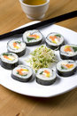 Korean style sushi and a cup of tea. Stock Photo