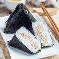 Korean triangle kimbap Samgak made with nori, rice and tuna fish, similar to Japanese rice ball onigiri, square Royalty Free Stock Photo