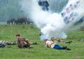 Kornilovs hiking squad lying down russia chernogolovka may on grass and shoot on history reenactment of battle of civil war in on Royalty Free Stock Photo